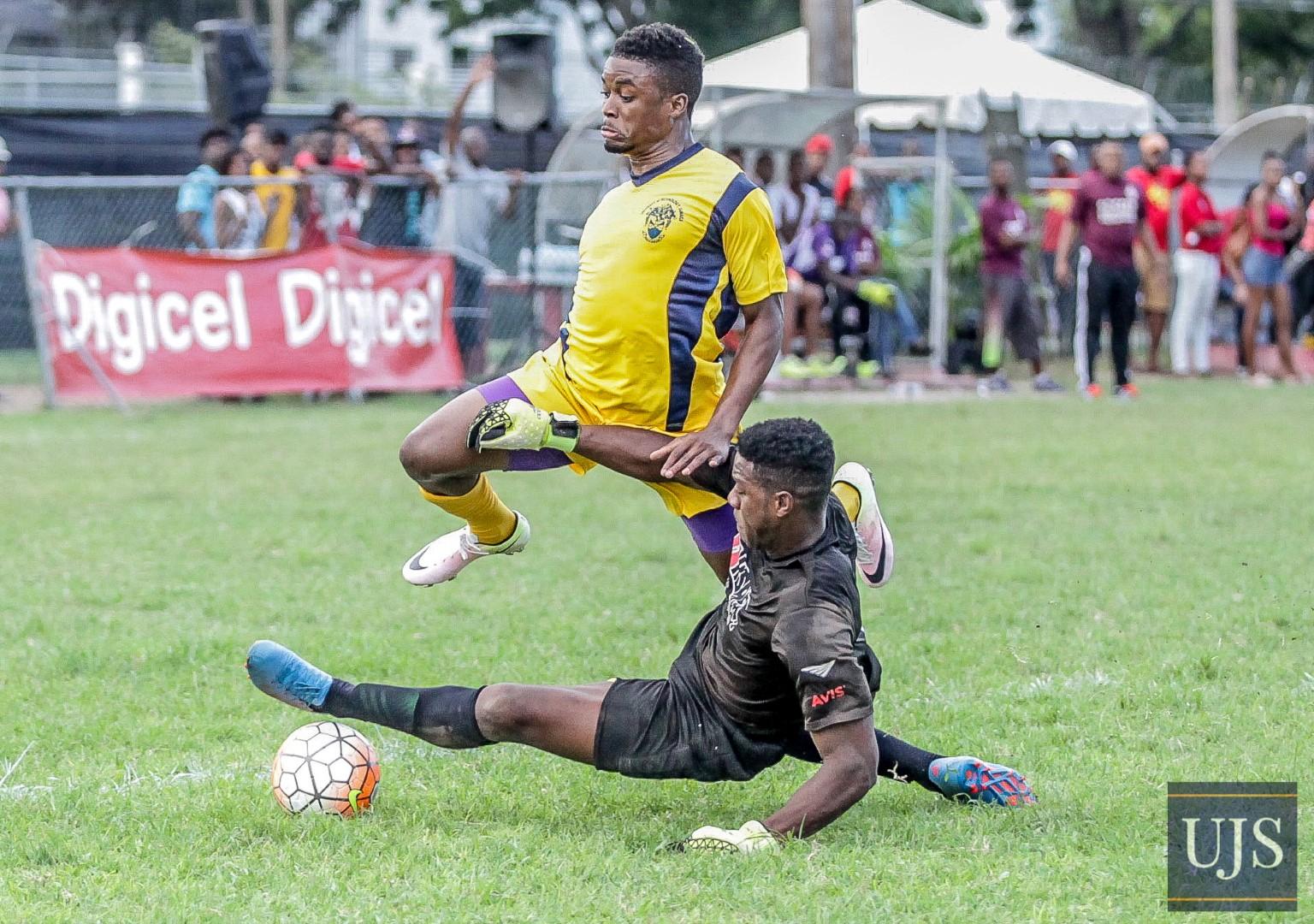 University of Technology, Ja forward player Dorvil Jackson skips away from UWI Mona custodian in an enticing football encounter at the UWI/UTech Games